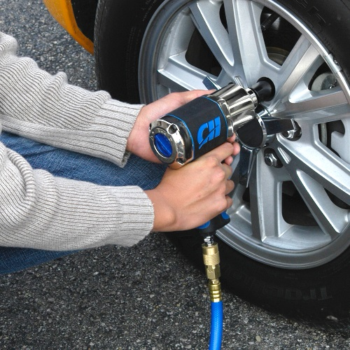 Man using Campbell Hausfeld 1/2-Inch Impact Wrench on hub caps 3